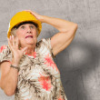 Afraid Senior Woman Wearing Hardhat — Stockfoto