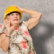 Afraid Senior Woman Wearing Hardhat — Stock Photo