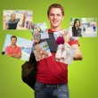 Young Man Holding Digital Tablet With Photos — Stock fotografie