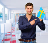 A Young Man Holding A Flag Of Sweden — Stock Photo