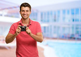 Man Holding Camera — Stock Photo