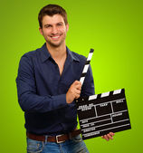 A Young Man Holding A Clapboard — Stock Photo