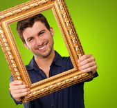A Young Man Holding And Looking Through Frame — Stock Photo