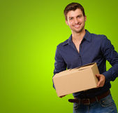 A Young Man Holding Cardboard Box — Stock Photo