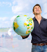 A Young Man Holding Globe — Stock Photo