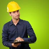 Male Architect Writing On Clipboard — Stock Photo
