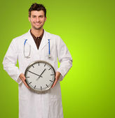 Portrait Of A Doctor Holding Clock — Stock Photo