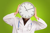 Doctor Hiding Face With Clock — Stock Photo
