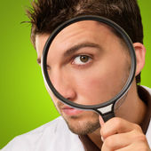 Doctor Looking Through Magnifying Glass — Stock Photo