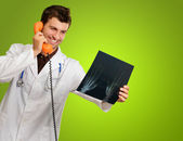 Doctor Holding Phone And X-ray — Stock Photo
