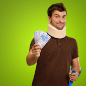 Young Man Wearing Cervical Collar Holding Euro Note — Stock Photo
