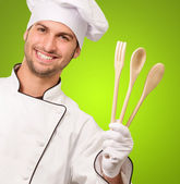 Portrait Of Male Chef Holding Wooden Spoon — Stock Photo