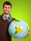 Young Man With Globe And Snorkel — Stock Photo