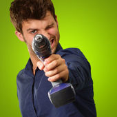Man Aiming With Drill Machine — Stock Photo