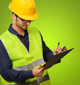 A Young Engineer Writing On Clipboard — Stock Photo