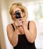 Mature Woman Looking Through Camera — Stock Photo