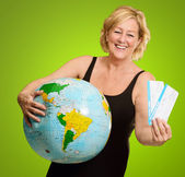 Woman Holding Globe And Boarding Passes — Stock Photo