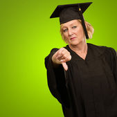 Mature Graduate Woman Showing Thumb Down — Stock Photo