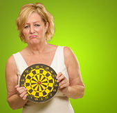 Sad Mature Woman Holding Dartboard — Stock Photo