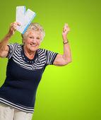Portrait Of Senior Woman Holding Boarding Pass Cheering — Stock Photo