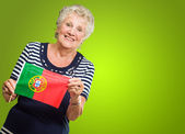 Happy Senior Woman Holding Portugal Flag — 图库照片