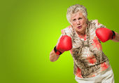 Angry Mature Woman Wearing Boxing Glove — Stock Photo