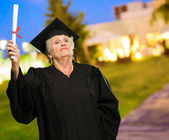 Senior Woman Holding Degree In Hand — Stock Photo