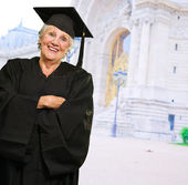 Senior Woman In Graduate Gown — Stockfoto