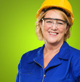 Portrait Of Happy Mature Woman Wearing Hardhat And Protective Ey — Stock Photo