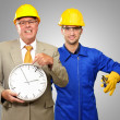Stock Photo: Architect Engineers Holding Clock And Plier