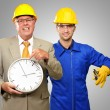 Architect Engineers Holding Clock And Plier — Stock Photo