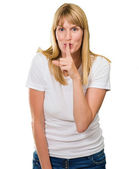 Woman With Finger On Lip — Stock Photo