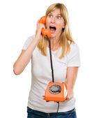 şok kadın telefonla konuşuyor — Stok fotoğraf