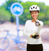 Cyclist Woman Showing Thumb Up — Stock Photo