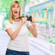 Shocked Woman With Old Camera — Stock Photo #14053608
