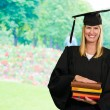 Happy Graduate Woman Holding Books — Stock Photo
