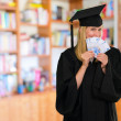 Graduate woman holding euro notes — Stock Photo
