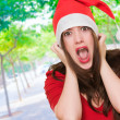 Furious woman wearing a christmas hat — Stock Photo