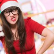 Angry christmas woman wearing glasses - Stock Photo