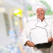 Male Chef Stirring A Non Stick Pan, Background — Stock Photo #14056347