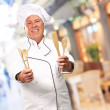 Stock Photo: Potrait Of Chef While Holding Spoon