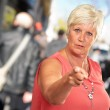 Portrait Of A Senior Woman Pointing Finger — Stock Photo #14056517