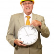 Portrait Of A Senior Man Holding A Wall Watch — Stock Photo #14056621