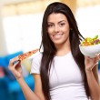 Female Holding A Piece Of Pizza And Salad Bowl — Stock Photo #14057131