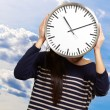Young Girl Showing Clock And Hiding Her Face — Stock Photo #14057537