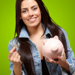 Portrait Of A Female Holding A Coin And Piggybank — Stock Photo #14057640