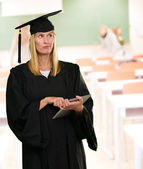 Confused Graduate Woman Holding Digital Tablet — Stock Photo