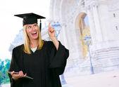 Graduate Woman Holding Digital Tablet — Stock Photo