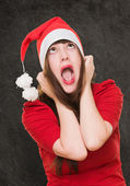 Stressed woman wearing a christmas hat — Stock Photo