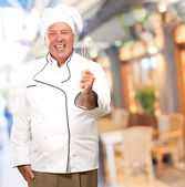 Portrait Of A Senior Male Chef Holding A Beater — Stock Photo